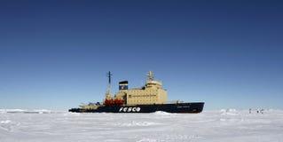 Icebreaker on Antarctica. Icebreaker parked in the ice on Antarctica Stock Photo
