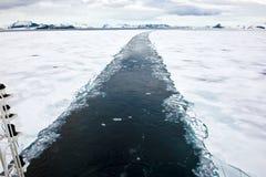 Icebreaker in Antarctica. Icebreaker breaking the sea ice in Antarctica. Icebreaker clears the way Stock Photo