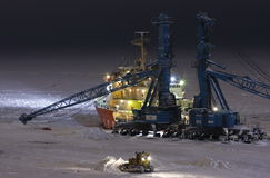 Icebreaker Dudinka and port crane. Sea port Dudinka, Russian Federation, December 2011 stock image
