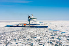Icebreaker Kontio. Approaches to port of Kokkola, Bay of Bothnia, Finland - March 30, 2011: Icebreaker Kontio making its way through ice.  i/b Kontio is 99 Royalty Free Stock Photo