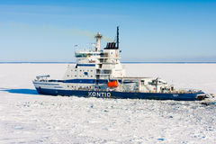 Icebreaker Kontio. Approaches to port of Kokkola, Bay of Bothnia, Finland - March 30, 2011: Icebreaker Kontio making its way through ice.  i/b Kontio is 99 Stock Photos
