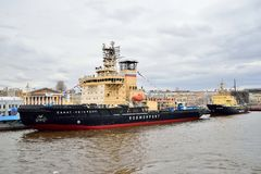 Icebreaker Saint Petersburg and Ivan Kruzenshtern moored at the. ST.PETERSBURG, RUSSIA - APRIL 30, 2017:  Icebreaker Saint Petersburg and Ivan Kruzenshtern Stock Image