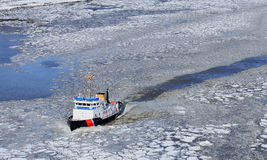 Icebreaker ship in frozen Hudson river Stock Image
