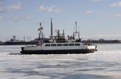 Icebreaker Ship Navigating on a Frozen Lake. Icebreaker ship going trough the ice of a frozen lake Stock Photos