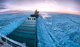 Icebreaker towing cargo ship royalty free stock photo