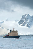 Icebreaker which floats on the frozen Strait spring Royalty Free Stock Images