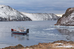 Icebreaking ferries arriving at port Stock Images