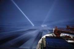 Icebreaking at night Stock Images