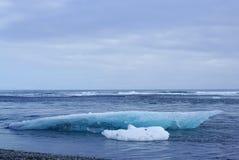 Iceburg on the black rock beach Royalty Free Stock Photography
