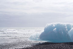 Iceburg on the black rock beach Stock Images