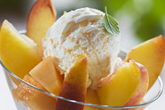 Icecream. Refreshing peach ice cream in a glass close up Stock Images