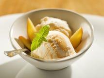 Icecream. Refreshing peach ice cream in a bowl close up Stock Photos