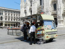 Icecream car on the square before the cathedral in Royalty Free Stock Photos