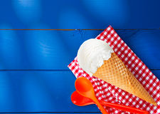 Icecream cone on checkered napkin Stock Photo