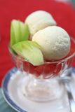 Icecream and fruit. With red background Royalty Free Stock Photo