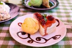 Icecream and layered cake Stock Image
