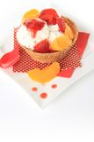 Icecream sundae. Vanilla Ice cream sundae with strawberry and peach Stock Photo