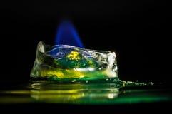 Icecube på brand - smälta ner förkylningen royaltyfria foton