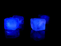 Icecubes. On black surface Royalty Free Stock Photography
