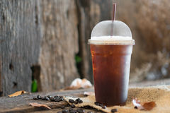 Iced Americano. Black coffee on a wooden table royalty free stock photo