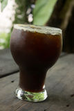 Iced Americano. Delicious ice coffee americano on wood table royalty free stock photos