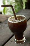 Iced Americano. Delicious ice coffee americano on wood table stock images