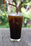Iced Americano. Delicious ice coffee americano on wood table stock photo