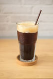 Iced americano. On wood table in cafe shop royalty free stock images