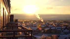 Iced balconies, trees and snowy roofs, sunset timelapse. Iced balconies, trees and snowy roofs at sunset stock footage