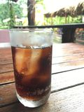 Iced beverage. Iced cola flavor on wood table Royalty Free Stock Photo