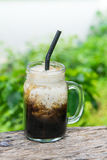 Iced black coffee with fresh milk in jar vintage mug glass cups on the table Royalty Free Stock Images