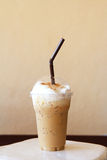 Iced blended frappucino. On brown background royalty free stock photography