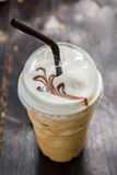 Iced blended frappucino in plastic cup. Iced coffee. Iced blended frappucino in plastic cup on wood background. Iced coffee royalty free stock images