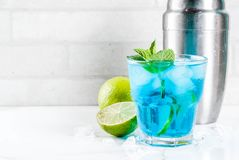 Iced blue alcohol cocktail stock image