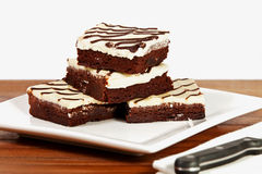 Iced Brownies on a plate Stock Image