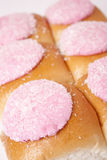 Iced Buns. A group of pink iced buns Stock Photography