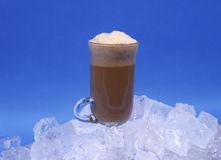 Iced Cappuccino. Cappucino drink in ice on blue background in studio royalty free stock images
