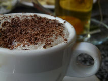 Iced cappuccino. The cup iced cappuccino with chokolate in a cafe Royalty Free Stock Photo
