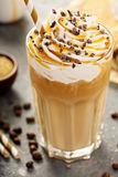Iced caramel latte coffee in a tall glass stock photography