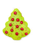 Iced Christmas cookie tree. Green iced Christmas butter cookie with red hots isolated on a white background in Christmas tree shape Royalty Free Stock Photos
