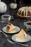 Iced Cinnamon Bundt Cake Slices and Tea Stock Images