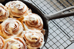 Iced Cinnamon Buns in Cast Iron Skillet Stock Photos