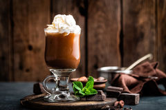Iced cocoa drink with whipped cream, cold chocolate beverage, coffee frappe. On dark background royalty free stock photography
