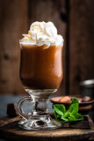 Iced cocoa drink with whipped cream, cold chocolate beverage, coffee frappe. On dark background royalty free stock photos