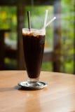 Iced coffee americano. On green background stock photo