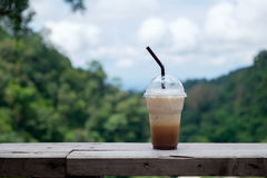 Iced coffee on balcony with Mae Kampong village background Royalty Free Stock Photos