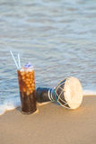 Iced coffee on the beach Stock Image