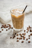 Iced coffee with beans for cold summer drink on stone background Royalty Free Stock Images