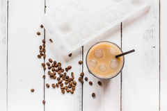Iced coffee with beans for cold summer drink on white background top view Royalty Free Stock Photo
