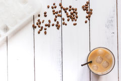 Iced coffee with beans for cold summer drink on white background top view Stock Photo